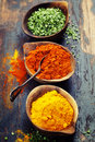 Various spices and herbs curry paprika dry chives over wood Royalty Free Stock Image