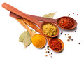 Various spices and herbs over white curry saffron turmeric cinnamon Royalty Free Stock Photo