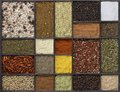 Various spices lots of different in a framed dark wooden box seen from above Stock Photo