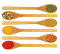 Various spices in wooden spoons isolated Stock Image