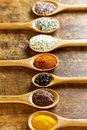 Various spices in wooden spoons on a table Royalty Free Stock Photo
