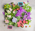 Various summer flowers in pots with garden sign preparation of garden bed of flowers in pots top view Stock Images