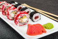 Various sushi rolls on white background
