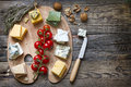 Various types of cheese on abstract vintage paint palette Royalty Free Stock Photo