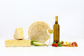 Various types of cheese with wine, tomatoes, basil, olives, ham, Royalty Free Stock Photo