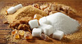 Various types of sugar on wooden table Royalty Free Stock Photos
