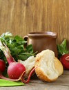 Various vegetables and herbs bread and milk rustic still life Stock Images
