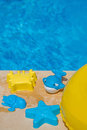 Various water toys on the side of a swimming pool Royalty Free Stock Photo
