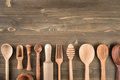 Various wooden kitchen utensils on table Royalty Free Stock Photo
