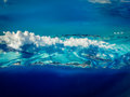 Varying shades of blue pattern the water in caribbean islands aerial view Royalty Free Stock Photography