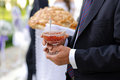Vase with jam man holding glass for ceremony Royalty Free Stock Photos