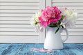 Vase of peony blooms Royalty Free Stock Photo