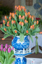 Vase of tulips big ceramic orange Royalty Free Stock Photography