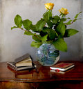 Vase wth flowers and old books on a table Royalty Free Stock Images