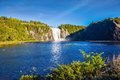 The vast blue lake and waterfall Royalty Free Stock Photo