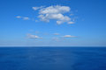 Vast deep blue sea with clouds Royalty Free Stock Photo