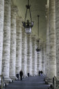 Vatican colonnades rome people walking under in Stock Photos