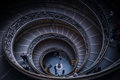 Vatican staircaise tourists descending by the spiral staircase of the museums city Stock Photos