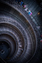 Vatican staircaise tourists descending by the spiral staircase of the museums city Royalty Free Stock Photography