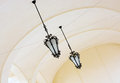 Vaulted ceiling with ornate iron lamps historical Stock Images