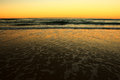 Vaves gold beach sunset beautiful colors Stock Photography