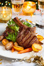 Veal chop with vegetables for christmas dinner Stock Photography