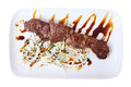 Veal skewer with salad on a white platter isolated on white background top view Stock Photography