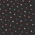 Vector abstract starry seamless pattern on the gray background.