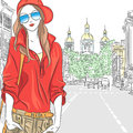 Vector beautiful fashion girl top model on the str fashionable attractive in red blouse cap and glasses in street in st petersburg Stock Image