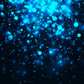 Vector blue glowing light glitter background. Magic glow light effect. Star burst with sparkles on dark background Royalty Free Stock Photo