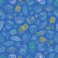 Vector blue tropical pattern with ginger flowers, basket plants and bali style ceramic pots. Perfect for fabric, scrapbooking,