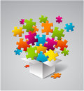 Vector box full of colorful puzzles Royalty Free Stock Photos