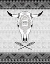 Vector card with crossed ethnic arrows and bull skull on the tribal ornamental background.