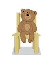 Vector cartoon teddy bear sitting on the chair.