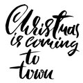 Vector Christmas calligraphy. Handwritten modern dry brush lettering. Typography poster. Christmas is coming to town. Royalty Free Stock Photo