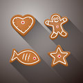 Vector christmas gingerbread heart fish star and man on dark background Royalty Free Stock Image