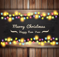 Vector christmas lights on wooden boards and chalkboard illustration template design Stock Photos
