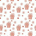 Vector Christmas seamless background with Christmas gifts, stars, snowflakes Royalty Free Stock Photo