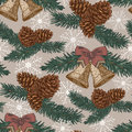 Vector Christmas seamless pattern with fir tree, fir cones, bells in vintage style. Royalty Free Stock Photo