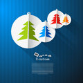 Vector christmas theme colorful paper trees on blue cardboard paper background Royalty Free Stock Image