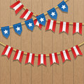 Vector colorful bunting decoration in colors of USA flag. Patriotic illustration with stars and stripes. Royalty Free Stock Photo