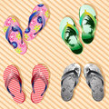 Vector colorful flip flops on bamboo wood texture background Stock Photos