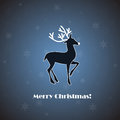 Vector deer on blue background with snowflakes Stock Images