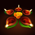 Vector diwali design with diya and leaf Royalty Free Stock Photos