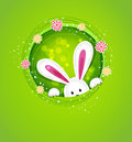 The vector easter bunny peeking out of a hole Stock Images