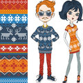 Vector fashion hipster boy and girl in knitted swe sweaters with norwegian seamless pattern Royalty Free Stock Photo