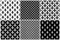 Vector fleur de lis seamless patterns set in black and white Royalty Free Stock Photo