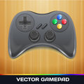 Vector gamepad game controller icon on wood background Stock Photo