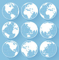 Vector globe earth icons on blue background Royalty Free Stock Photo