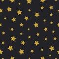Vector gold glitter stars seamless pattern black background Royalty Free Stock Photo